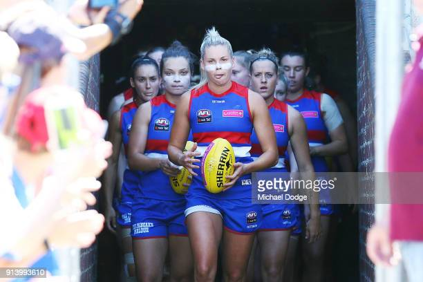 Kate Brennan of the Bulldogs leads the team out during the round one AFLW match between the Western Bulldogs and the Fremantle Dockers at Whitten...