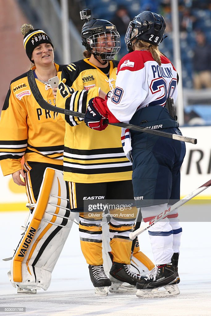 Kate Buesser #20 of the Boston Pride shakes hands with Marie-Philip Poulin #29 of of the Les Canadiennes skates against the Boston Pride in the Women's Hockey Classic on December 31, 2015 during 2016 Bridgestone NHL Winter Classic at Gillette Stadium in Foxboro, Massachusetts.