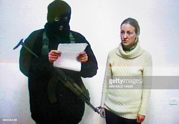 Kate Burton , a 25-year old Briton, kidnapped with her parents in Rafah in the southern Gaza Strip, appears with a militant on tv 30 December 2005....