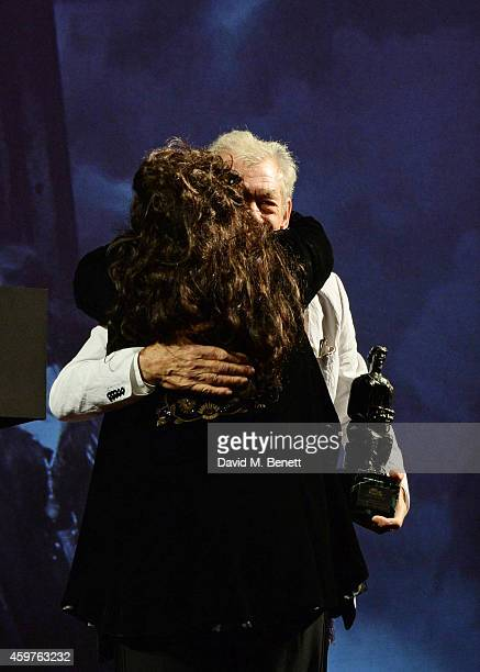 Kate Bush accepts the Editor's Award for 'Before The Dawn' from Sir Ian McKellen at the 60th London Evening Standard Theatre Awards at the London...
