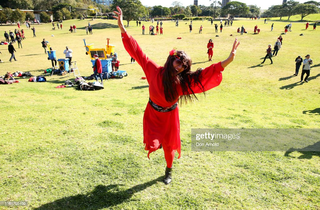 Kate Bush fans run up a hill at Sydney Park on July 13, 2019