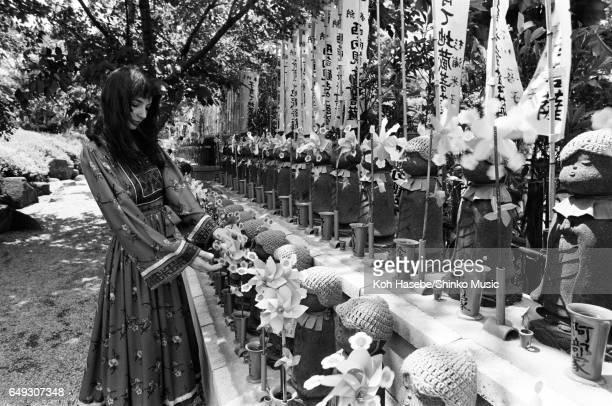 Kate Bush standing in front of Jizo Bosatsu Statue at Zojoji Temple June 1978