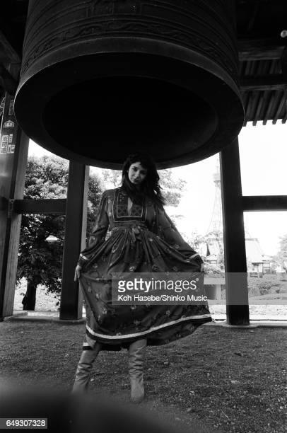 Kate Bush standing under the bell of Zojoj Templei June 1978