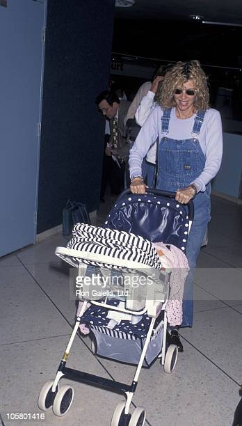 Kate Capshaw and baby during Kate Capshaw at Los Angeles International Airport May 21 1996 at Los Angeles International Airport in Los Angeles...
