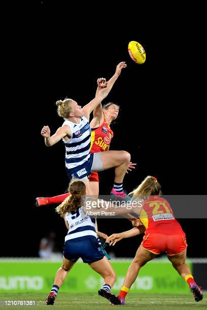Kate Darby of the Cats and Jasmyn Hewett of the Suns compete for the ball during the round five AFLW match between the Gold Coast Suns and the...