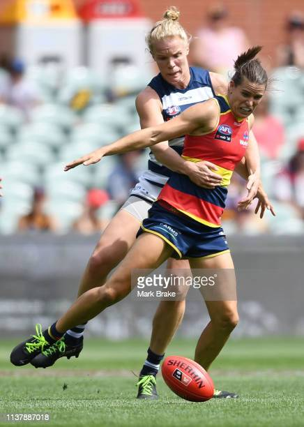 Kate Darby of the Cats competes with Chelsea Randall of the Adelaide Crows during the AFLW Preliminary Final match between the Adelaide Crows and...