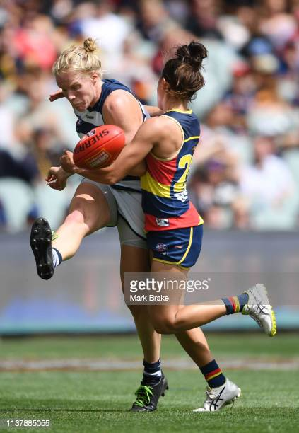 Kate Darby of the Cats kicks tackled by Justine Mules of the Adelaide Crows during the AFLW Preliminary Final match between the Adelaide Crows and...