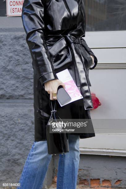 Kate Davidson Hudson is seen at Spring Studios outside the Phillip Lim show wearing black patent coat with waist tie denim jeans and circular black...