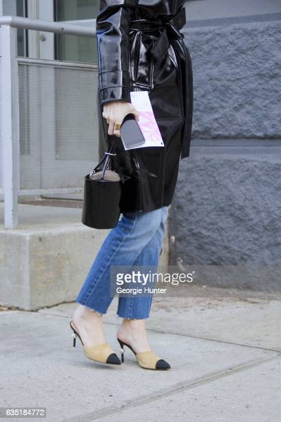 Kate Davidson Hudson is seen at Spring Studios outside the Phillip Lim show wearing black patent coat with waist tie denim jeans pointed toe suede...