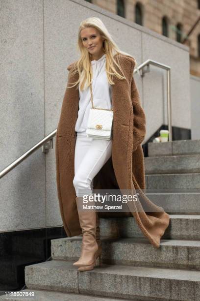 Kate Davidson Hudson is seen on the street during New York Fashion Week AW19 wearing brown wool coat with white outfit and white bag on February 09...