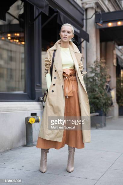 Kate Davidson Hudson is seen on the street during New York Fashion Week AW19 wearing khaki coat with brown leather skirt and taupe boots on February...