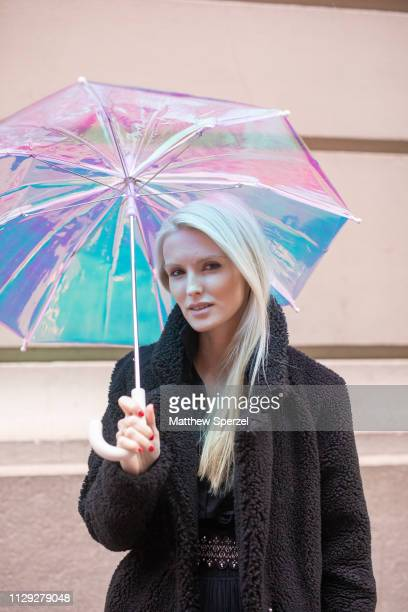 Kate Davidson Hudson is seen on the street during New York Fashion Week AW19 wearing black wool coat with multicolor pastel umbrella on February 12...