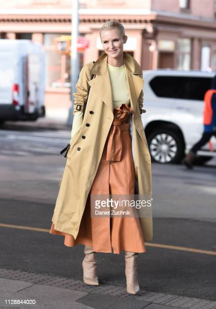 Kate Davidson Hudson is seen wearing a beige coat brown skirt and boots outside the Tory Burch show during New York Fashion Week Fall/Winter 2019 on...