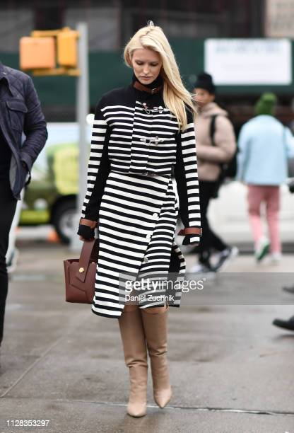 Kate Davidson Hudson is seen wearing a black and white striped dress and brown leather bag outside the Brock Collection show during New York Fashion...