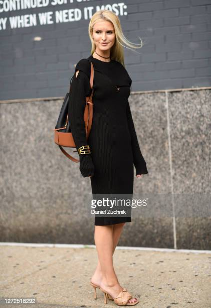 Kate Davidson Hudson is seen wearing a black sweater dress, brown bag, gold bracelet and tan heels outside the Monse show during New York Fashion...