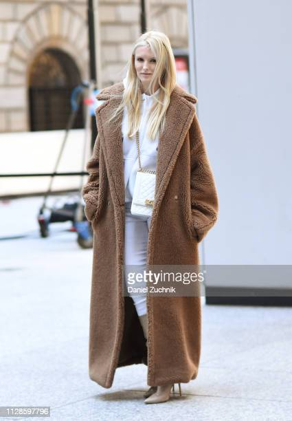 Kate Davidson Hudson is seen wearing a brown fur coat and white hoodie and pants with a Chanel bag outside the Longchamp show during New York Fashion...