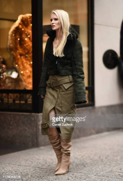 Kate Davidson Hudson is seen wearing a forest green coat and skirt with beige boots outside the 31 Phillip Lim show during New York Fashion Week...
