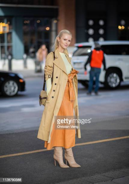 Kate Davidson Hudson is seen wearing beige trench coat belted high waist skirt outside Tory Burch during New York Fashion Week Autumn Winter 2019 on...