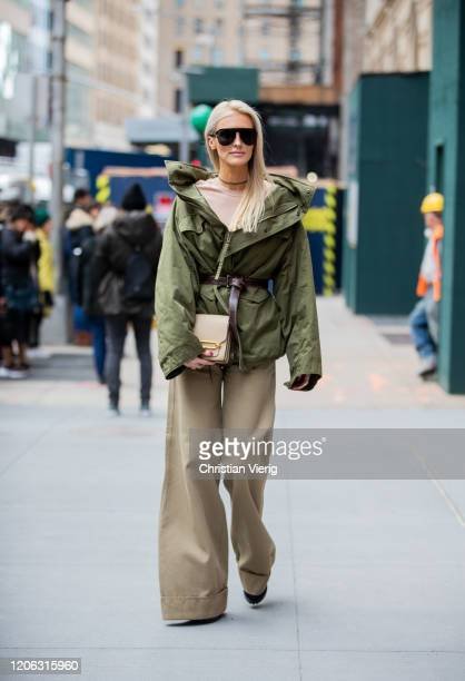 Kate Davidson Hudson is seen wearing green coat khaki pants outside Michael Kors during New York Fashion Week Fall / Winter 2020 on February 12 2020...