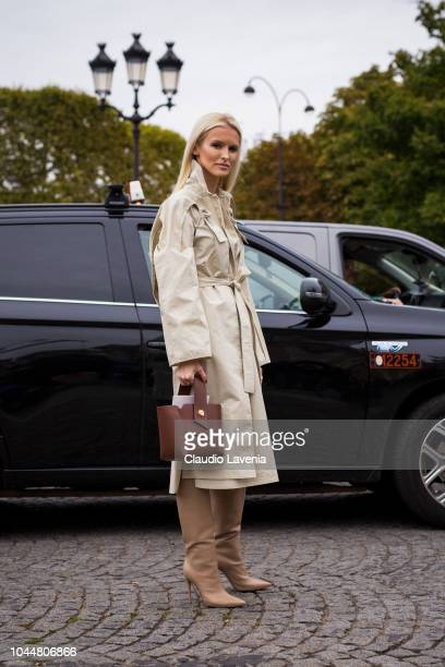 Kate Davidson Hudson wearing a beige trench coat beige boots and brown bag is seen before the Chanel show on October 2 2018 in Paris France