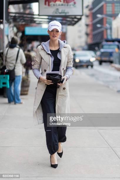 Kate Davidson Hudson wearing a white Balenciaga flex cap trench coat hoody outside Tory Burch on February 14 2017 in New York City