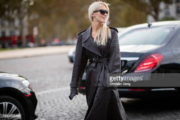 Kate Davidson Hudson wearing black coat with belt sunglasses is seen outside Valentino during Paris Fashion Week Womenswear Spring/Summer 2019 on...