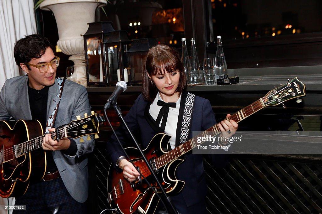 kate davis and band members perform at iris apfel x happy socks