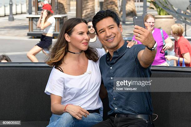 Kate del Castillo and Mario Lopez take a selfie together at Extra at Universal Studios Hollywood on September 21 2016 in Universal City California