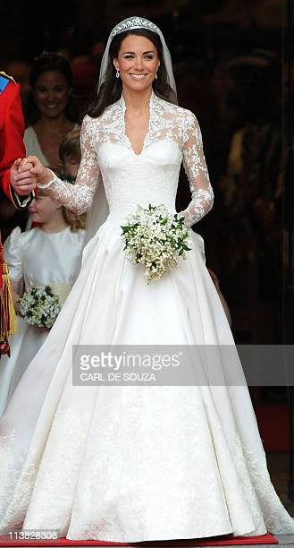 Kate, Duchess of Cambridge, comes out of Westminster Abbey, with her husband Britain's Prince William following their wedding ceremony, in central...
