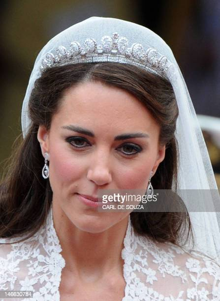 Kate Duchess of Cambridge wearing the 1936 Cartier 'halo' tiara which was lent to her by Queen Elizabeth II walks out of the West Door of Westminster...