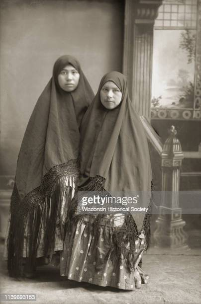 Kate Eagle left and her sister Minnie Eagle Black River Falls Wisconsin 1910 Both women are wearing fringed shawls over their heads
