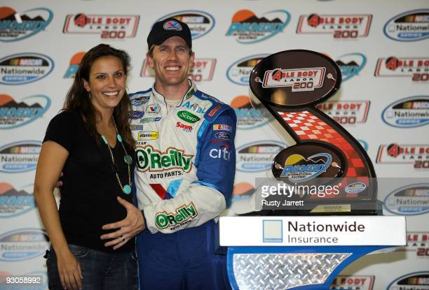 Kate Edwards and Carl Edwards driver of the Valvoline/O'Reilly Auto Parts Ford celebrate in victory lane after winning the NASCAR Nationwide Series...