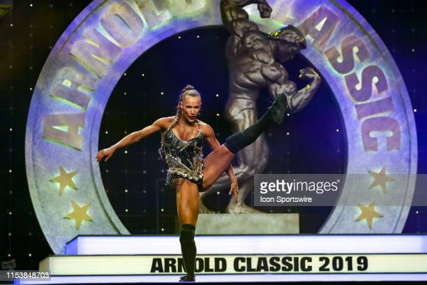 Kate Errington competes in Fitness International as part of the Arnold Sports Festival on March 1 at the Greater Columbus Convention Center in...