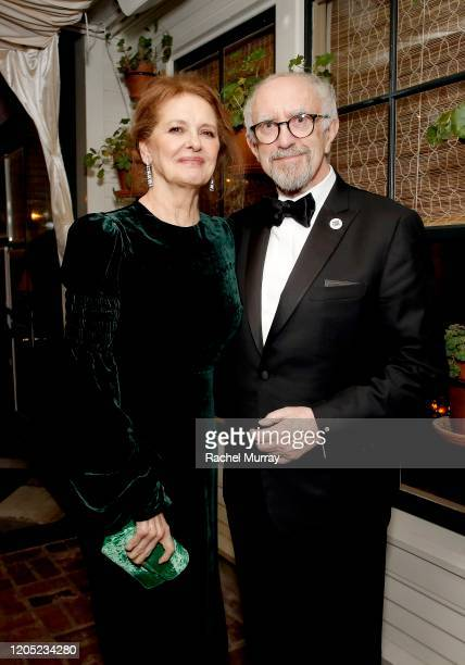 Kate Fahy and Jonathan Pryce attend the 2020 Netflix Oscar After Party at San Vicente Bugalows on February 09 2020 in West Hollywood California