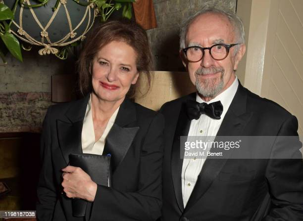 Kate Fahy and Jonathan Pryce pose the Netflix BAFTA after party at Chiltern Firehouse on February 2 2020 in London England