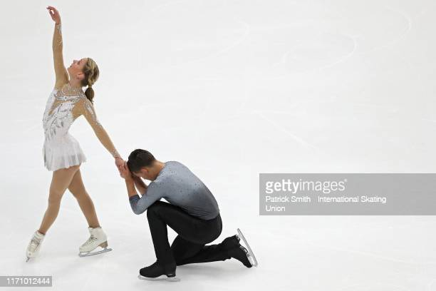 Kate Finster and Balazs Nagy of the United States perform in the Junior Pair Program during Day 1 of the ISU Junior Grand Prix of Figure Skating at...