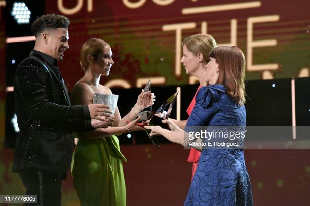 Kate Flannery and Jenna Fischer present Board of Governors Award to Austin McBroom and Catherine Paiz of The Ace Family onstage at Thirst Project...
