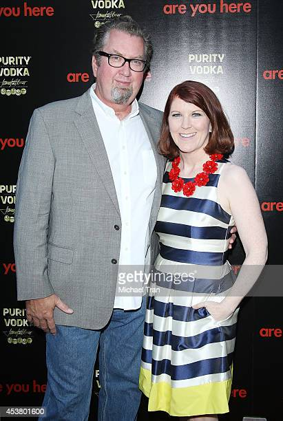Kate Flannery and photographer Chris Haston arrive at the Los Angeles premiere of Are You Here held at ArcLight Hollywood on August 18 2014 in...