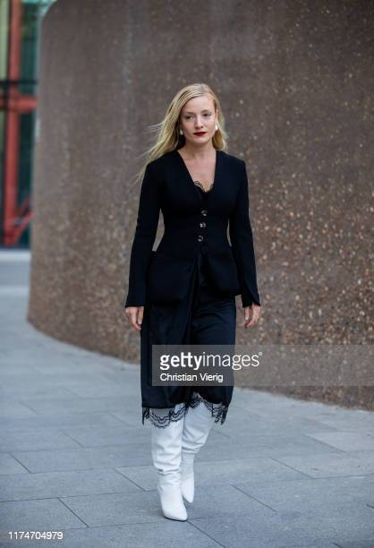 Kate Foley Osterweis is seen wearing black velvet blazer midi skirt white boots outside Ports 1961 during London Fashion Week September 2019 on...