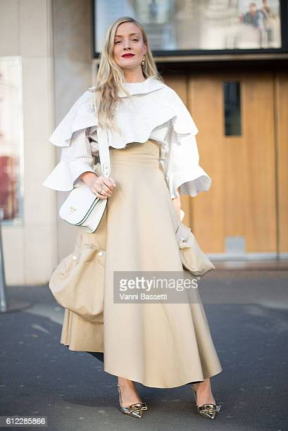 Kate Foley poses wearing an Awake dress and a Prada bag after the Olympia Le Tan show at the Rex Club during Paris Fashion Week Womenswear SS17 on...