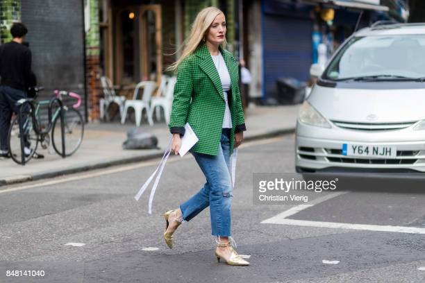 Kate Foley wearing green checked blazer denim jeans outside JW Anderson during London Fashion Week September 2017 on September 16 2017 in London...