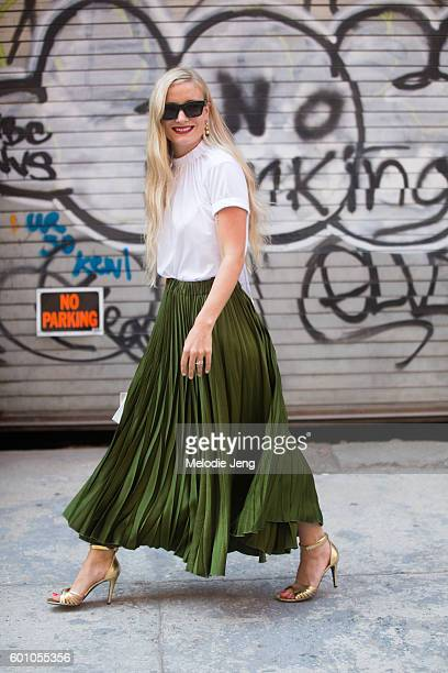 Kate Foley wears an olive green pleated skirt at the Brock Collection show at Milk Studios on September 8 2016 in New York City