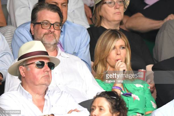 Kate Garraway appears to be vaping on Centre Court during day eleven of the Wimbledon Tennis Championships at All England Lawn Tennis and Croquet...