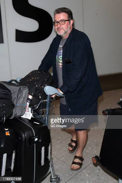 Kate Garraway's husband Derek Draper arrives at Heathrow Airport after returning from 'I'm A Celebrity... Get Me Out Of Here!' on December 11, 2019...