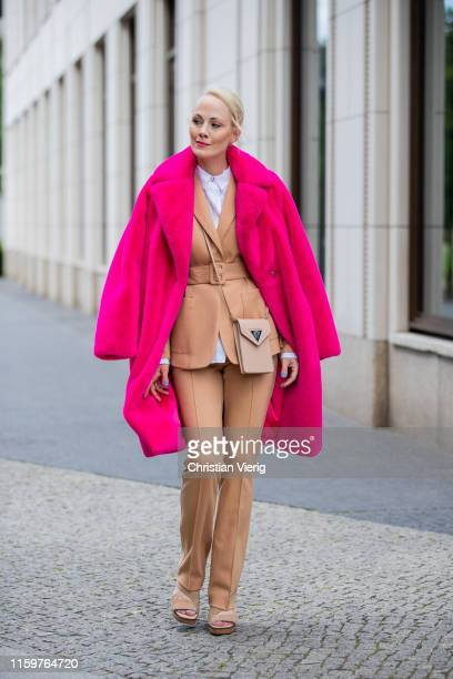 Kate Gelinsky is seen wearing total look Marc Cain brown suit pants and blazer, bag, pink teddy coat, white button shirt, sandals during Mercedes...