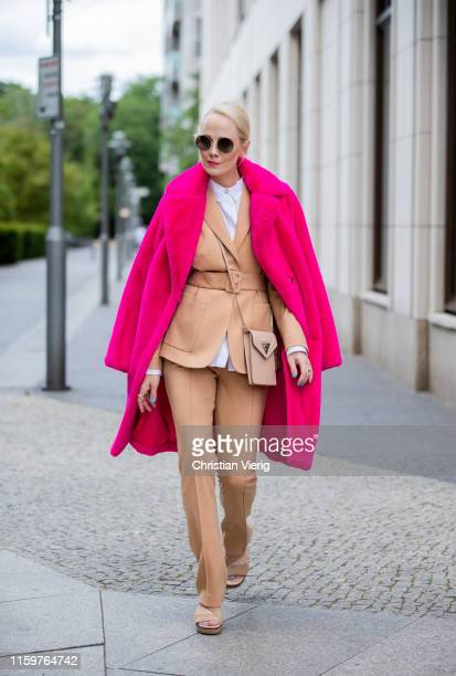 Kate Gelinsky is seen wearing total look Marc Cain brown suit pants and blazer bag pink teddy coat white button shirt sandals during Mercedes Benz...
