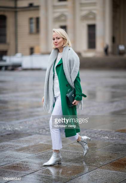 Kate Gelinsky is seen wearing total look Marc Cain including grey scarf with fringes green wool coat green bag white pants white blouse silver ankle...