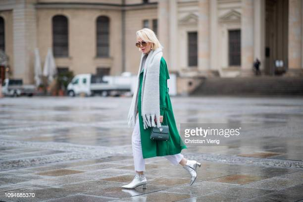 Kate Gelinsky is seen wearing total look Marc Cain including grey scarf with fringes, sunglasses, green wool coat, green bag, white pants, white...