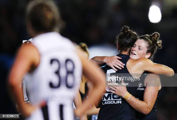 Kate GillespieJones and Brianna Davey of the Blues celebrate the win after the final siren during the round one AFLW match between the Carlton Blues...
