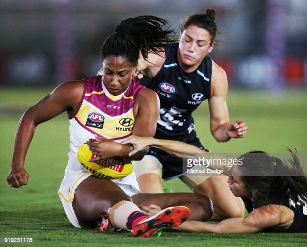 Kate GillespieJones and Danielle Hardiman of the Blues of the Blues tackle Sabrina FrederickTraub of the Lions during the round three AFLW match...